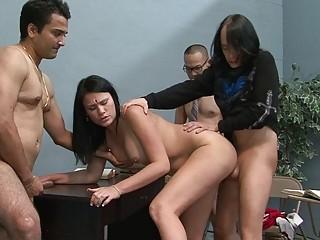 Kinky brunette slut gets drilled by three hunks on table
