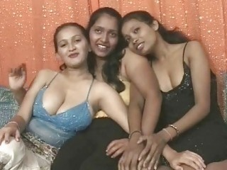 Smashing Indian babes have steamy lesbian threesome on the sofa